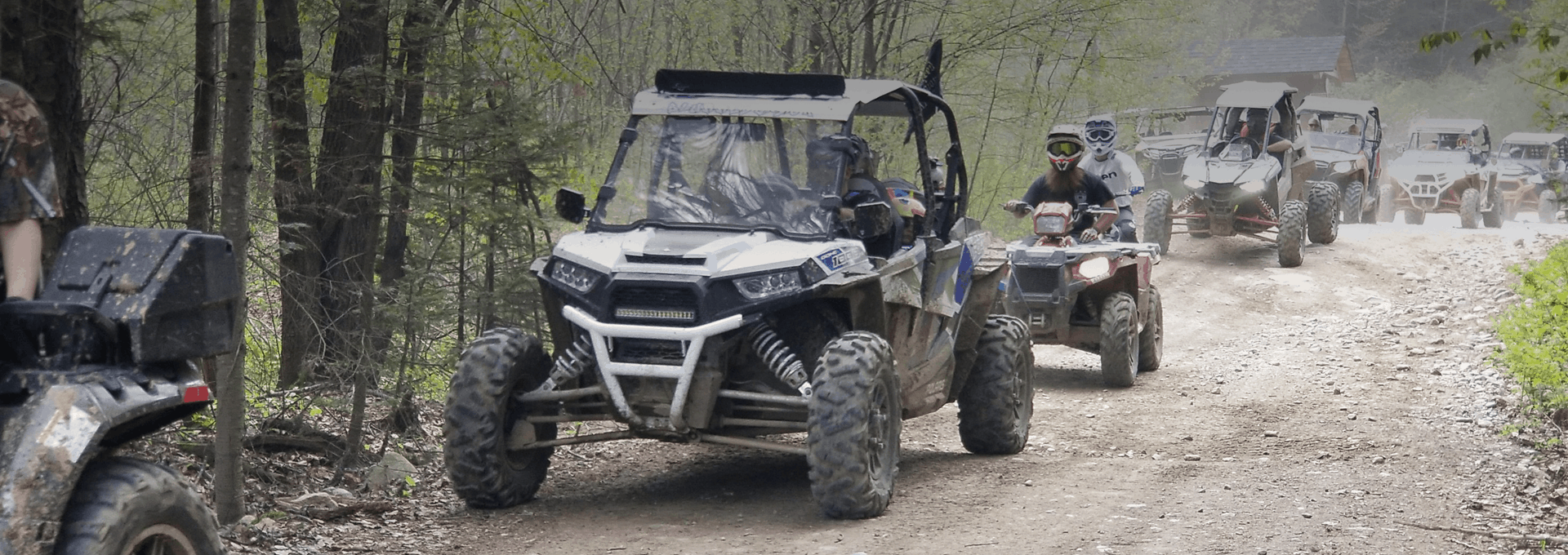 ATVs driving on a trail in Northern NH